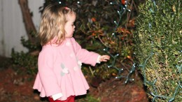 Child with Christmas lights