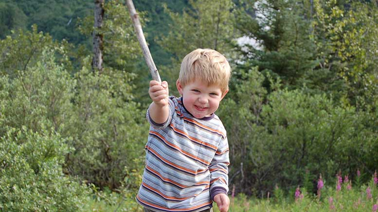 Boy with hiking stick