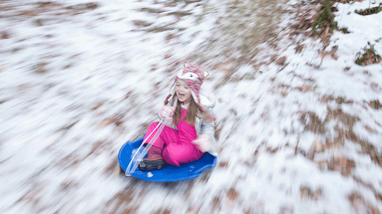 Child sledding in winter, Photo by Melissa Fassel Dunn. All rights reserved