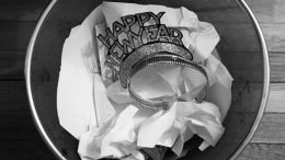 Happy New Year hat in trash