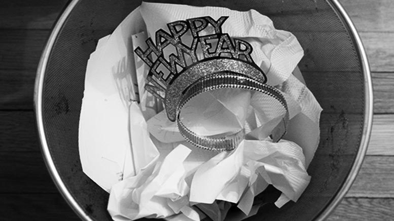 Happy New Year hat in trash