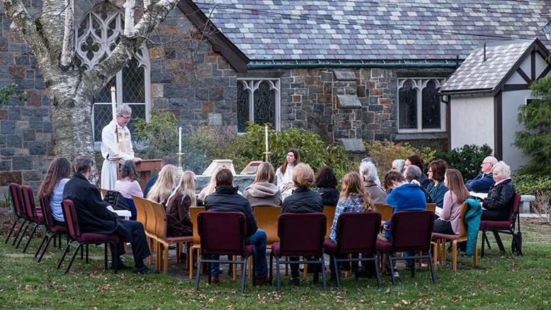 The Rev. Hall Kirkham hosts an outdoorSundayservice in St. Michael's Gardenof Seasons at112 Randolph Ave. in Milton, MA.