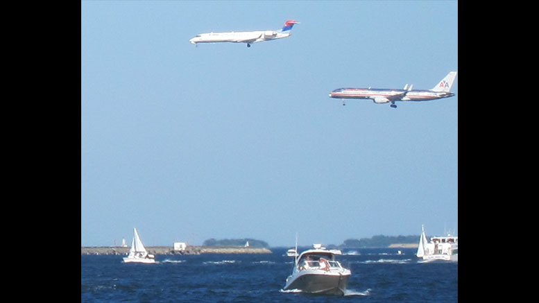 This image shows two planes landing in parallel on runways 4L and 4R, which both fly over Milton. The photo was taken by Professor Alvin Roth, the Gund Professor of Economics and Business Administration Emeritus at Harvard and winner of the 2012 Nobel Prize in Economics.