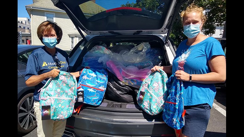 Jennifer White, left, Vice President of Community and Public Relations for HarborOne Bank, delivers backpacks to Interfaith Social Services' Family and Children Program Manager Emily Ryan, right. HarborOne employees donated and assembled 150 backpacks for Interfaith's 2020 Backpack Drive.