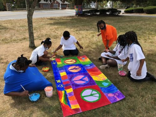 Milton residents Timothy O'Sullivan, Connor Finn, and Leah Medicke helped to create the panel of Love.
