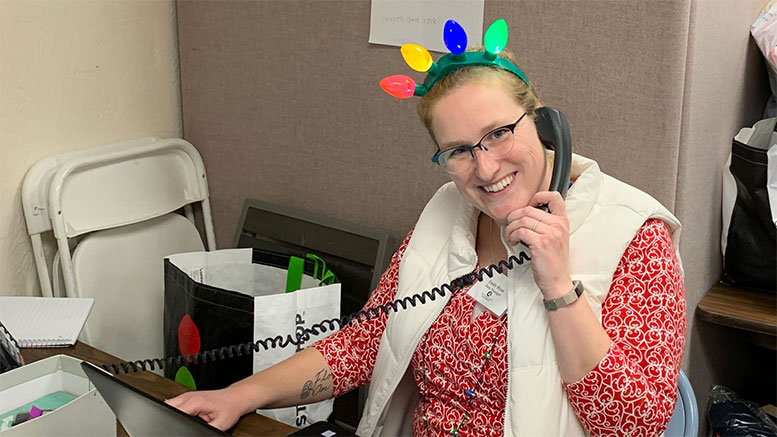Interfaith Social Services' Family and Children Program Coordinator Emily Ryan takes calls about Interfaith's Help for the Holidays program last winter. The agency is seeking sponsors to provide holiday gifts for 700 children this season.