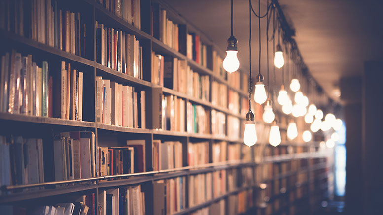 books in old bookstore with beautiful hanging lights