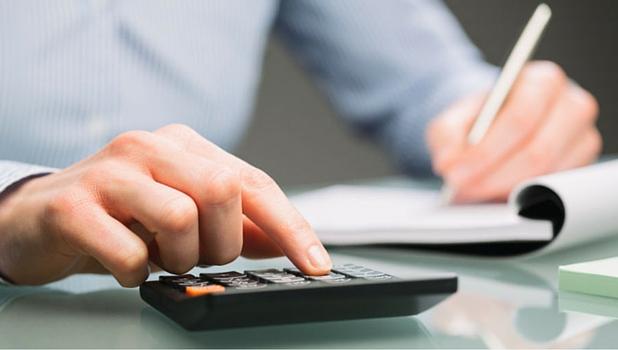 Person Using Calculator