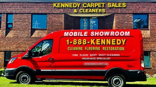 Kennedy Carpet logo and van